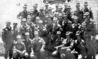 Разведка 317-го ПДП после строевого смотра с командующим ВДВ Д.С.Сухоруковым. Лето, 1985 г. Кабул, возле президентского дворца. Справа на фото - ротный старший лейтенант А. Н. Колпаченко, рядом в нижнем ряду – М. И. Тарасов, в центре – командир ВДВ, справа от него - командир 317-го ПДП подполковник А. В. Кинзерский, слева - комдив 103-й ВДД Ю. В. Ярыгин